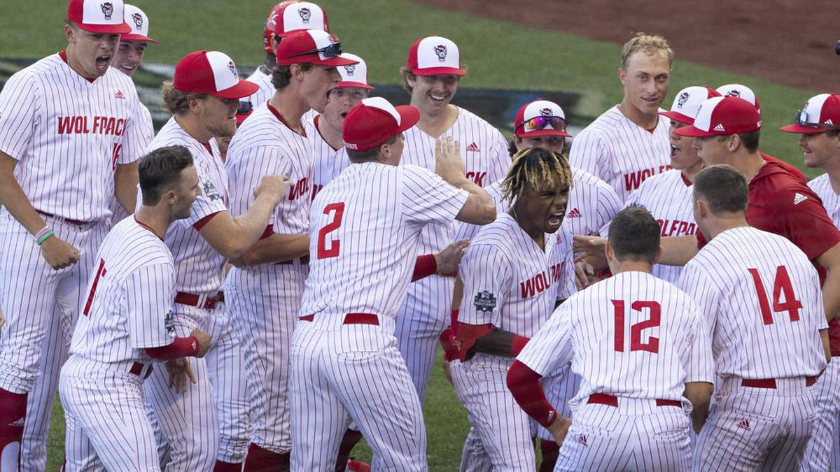 North Carolina State's Terrell Tatum, right center, celebrates with teammates after hitting a...