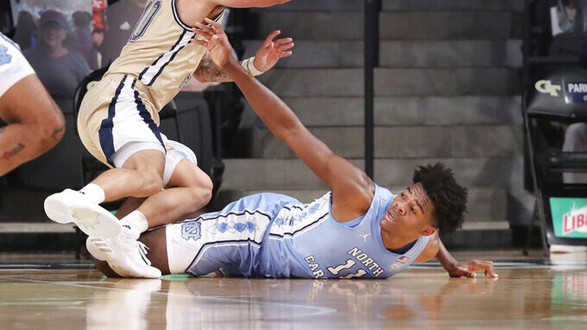 Georgia Tech guard Jose Alvarado steals the ball from North Carolina forward Day'Ron Sharpe...