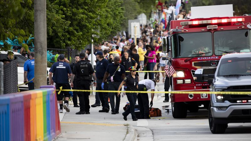 Police and firefighters respond after a truck drove into a crowd of people during The Stonewall...