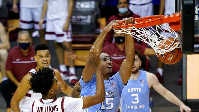 North Carolina forward Garrison Brooks (15) dunks past Stanford forward Ziaire Williams (3) in...
