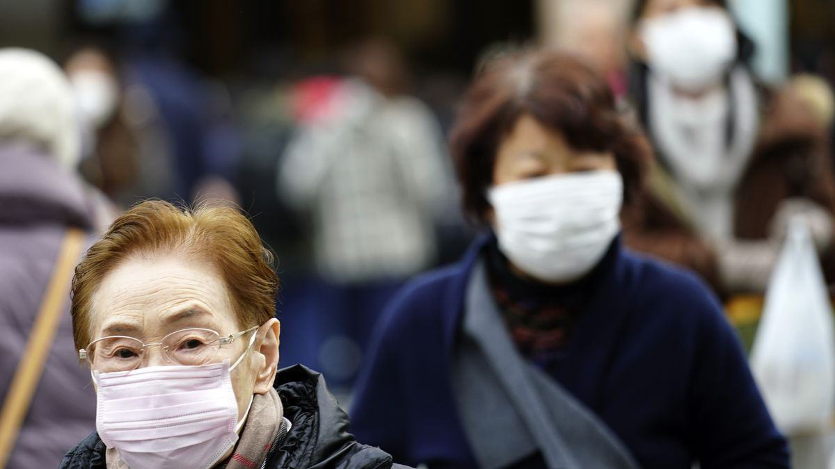 Pedestrians wear protective masks as they walk through a shopping district in Tokyo Thursday, Jan. 16, 2020. Japan's government said Thursday a man treated for pneumonia after returning from China has tested positive for the new coronavirus identified as a possible cause of an outbreak in the Chinese city of Wuhan. (Source: AP Photo/Eugene Hoshiko)