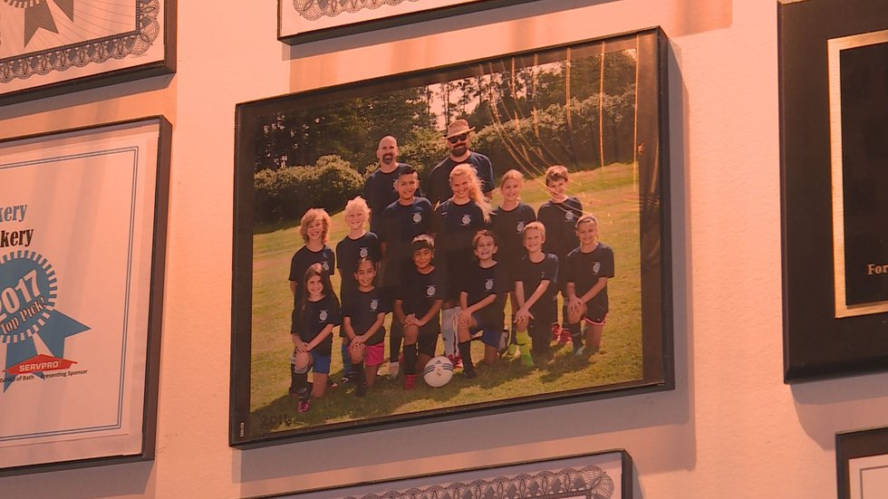 Anglemyer (Top right) coaching youth soccer.
