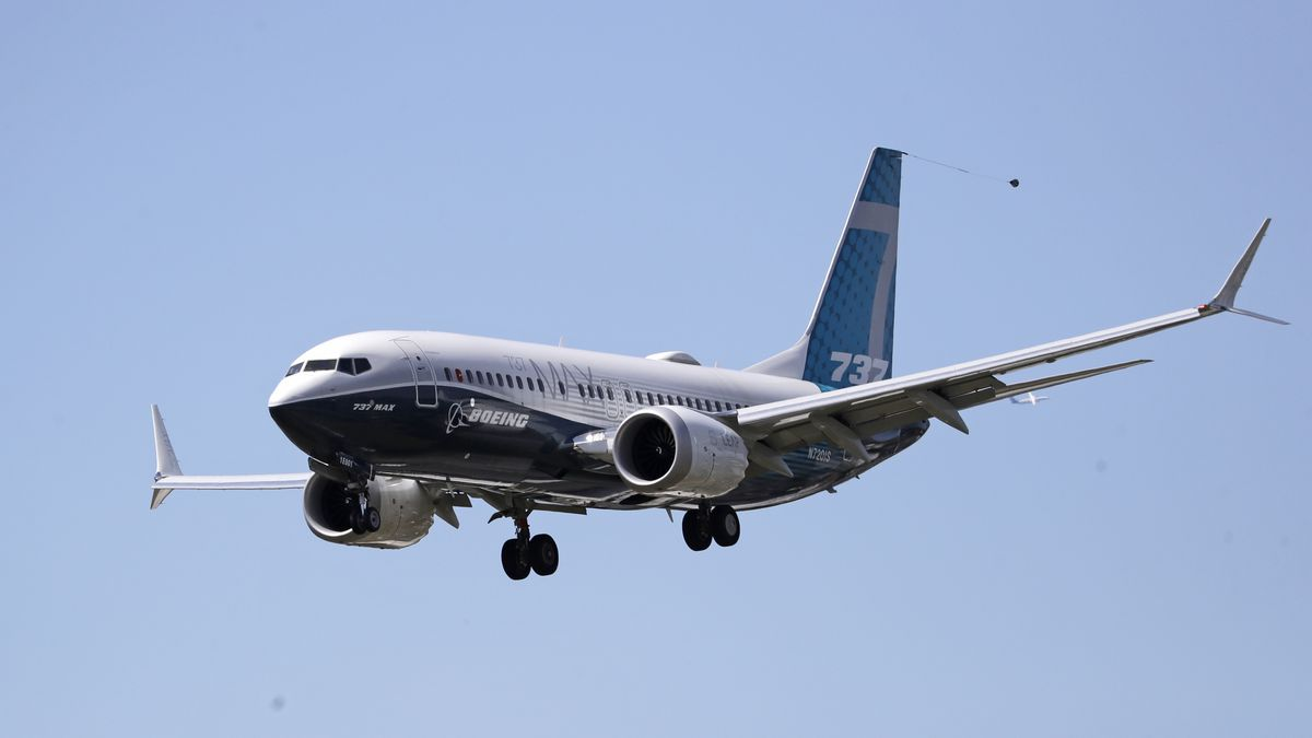 A Boeing 737 Max jet heads to a landing at Boeing Field following a test flight on Monday, June 29, 2020, in Seattle.