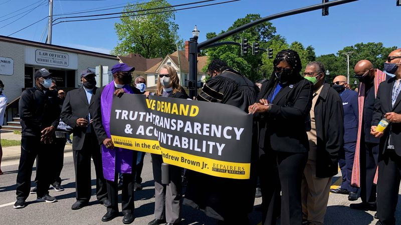 Faith leaders march in Elizabeth City on Saturday.