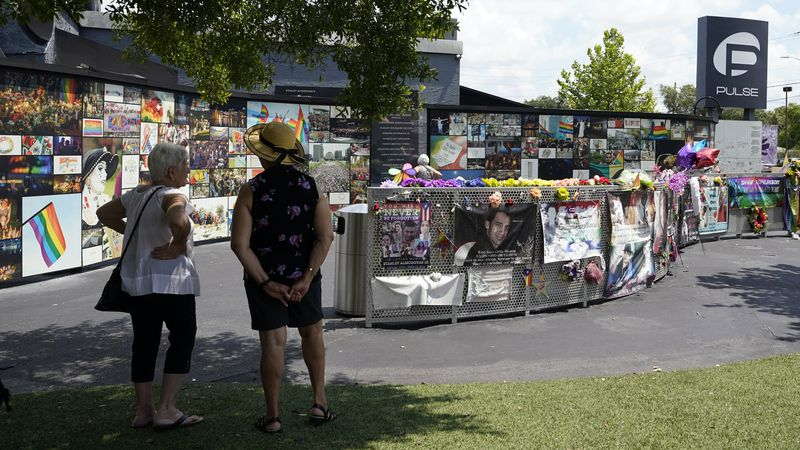 Visitors pay tribute to the display outside the Pulse nightclub memorial Friday, June 11, 2021,...