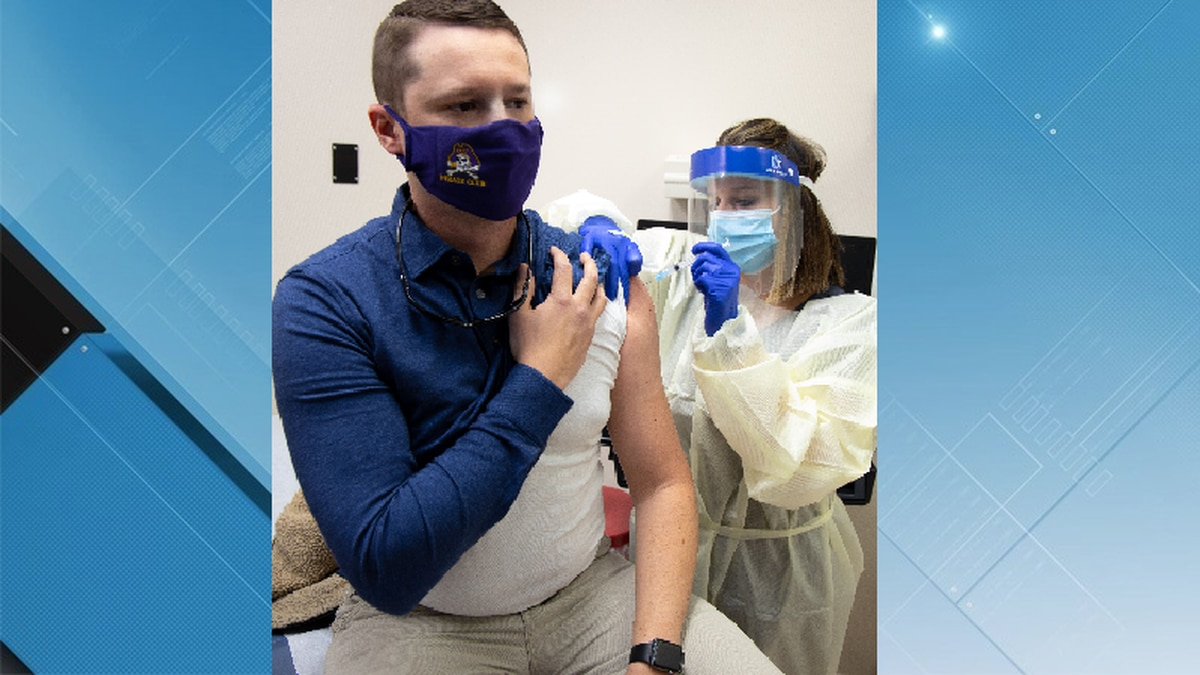 Dr. Adam Harrell receives one of the first Pitt County Health Department COVID-19 vaccinations
