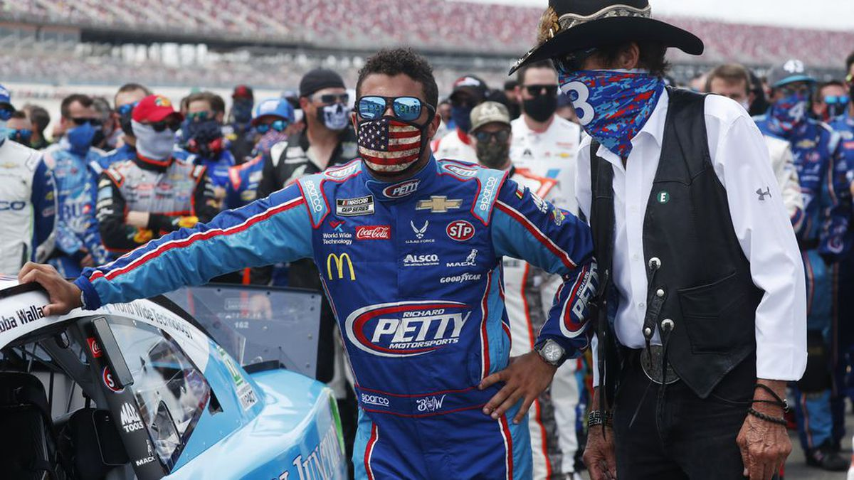 Team owner Richard Petty, right, stands with driver Bubba Wallace prior to the start of the NASCAR Cup Series at the Talladega Superspeedway in Talladega, Ala., Monday, June 22, 2020.(AP Photo/John Bazemore)