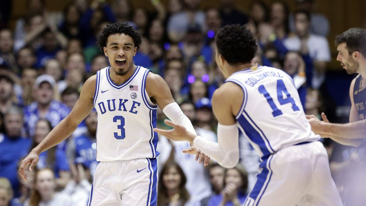 Duke guards Tre Jones (3) and Jordan Goldwire (14) reacts following a play against Notre Dame during the second half of an NCAA college basketball game in Durham, N.C., Saturday, Feb. 15, 2020. (AP Photo/Gerry Broome)