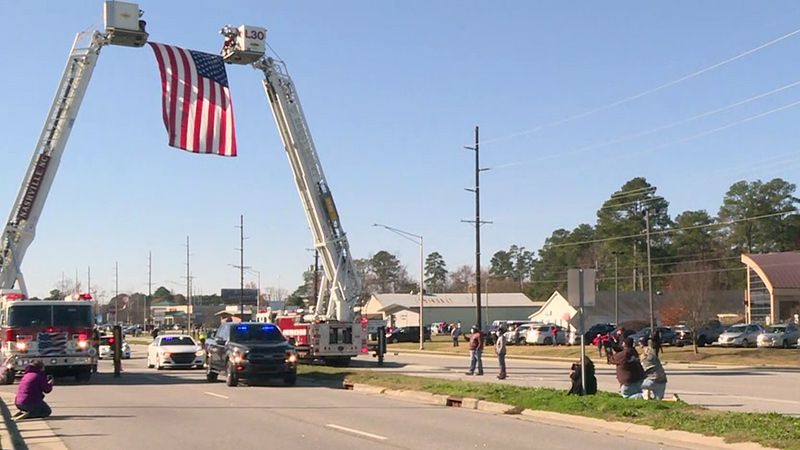 More than 100 emergency vehicles took part in the escort.