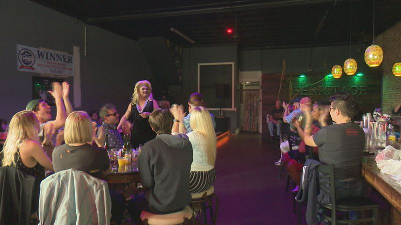 Drag Show happens in local bar while protestors stand outside.