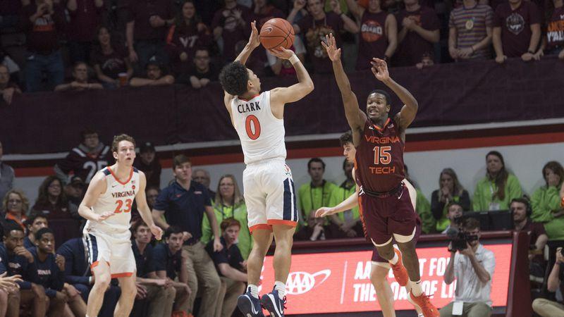Virginia guard Kihei Clark (0) shoots the go-ahead 3-pointer over Virginia Tech defender Jalen...