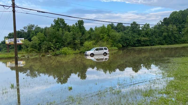 A car is stuck in high water on Evans Street near Arlington Boulevard Friday morning.