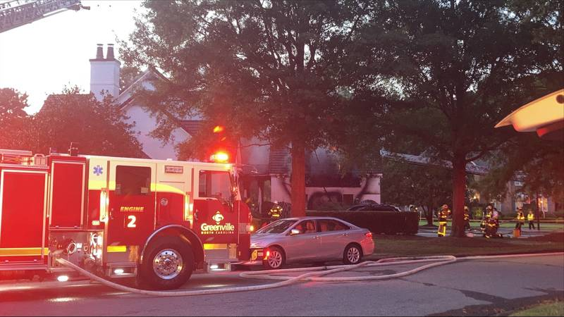 Crews worked to put out a fire at a home in Greenville on Saturday.