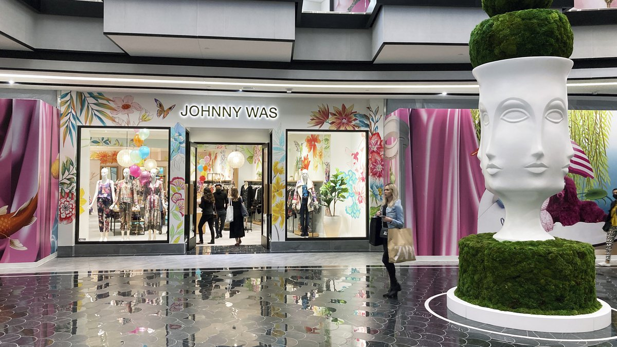 FILE - People shop at a Johnny Was clothing store in the luxury wing at the American Dream...