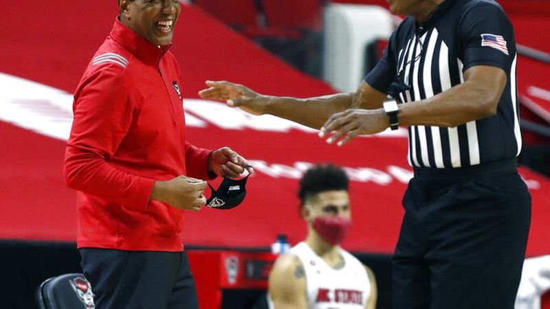 North Carolina State coach Kevin Keatts laughs at a call by official Ted Valentine during the...