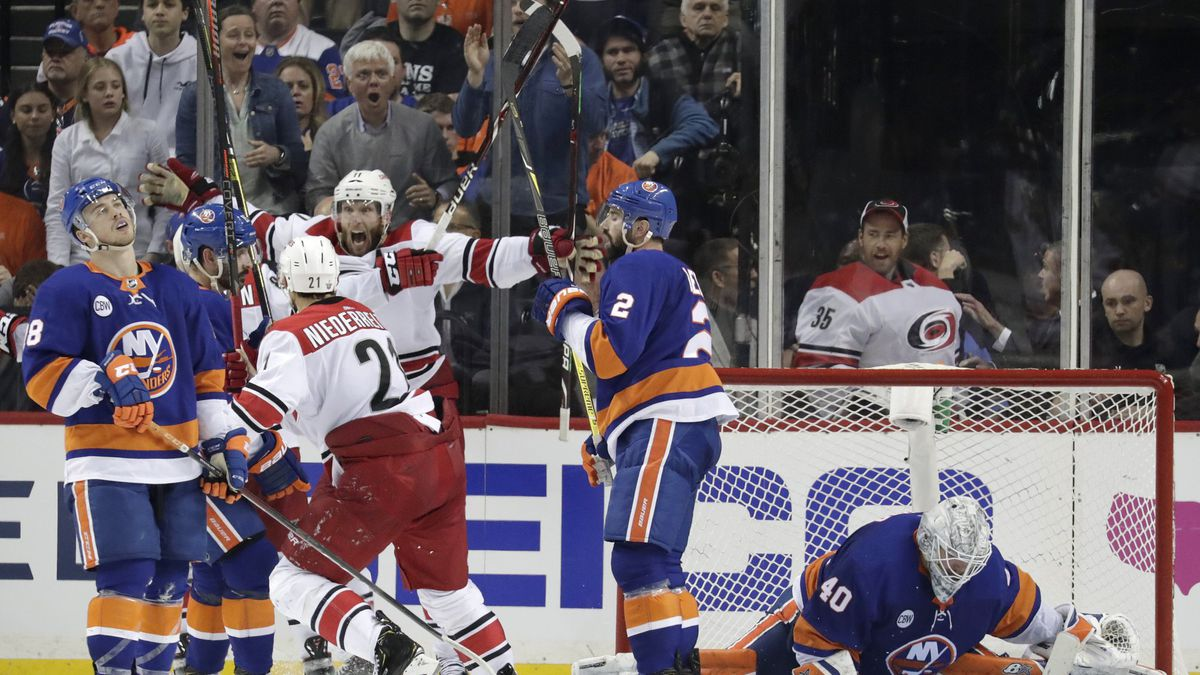Carolina Hurricanes center Jordan Staal, center left, reacts after scoring an overtime goal on New York Islanders goaltender Robin Lehner (40), of Sweden, during Game 1 of an NHL hockey second-round playoff series, Friday, April 26, 2019, in New York. The Hurricanes won 1-0. (AP Photo/Julio Cortez)