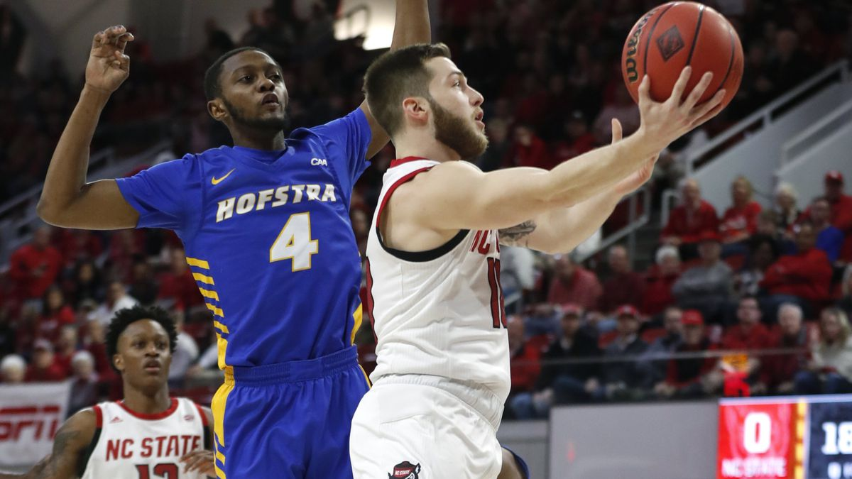North Carolina State's Braxton Beverly (10) drives to the basket past Hofstra's Desure Buie (4) during the first half of an NCAA college basketball game in Raleigh, N.C., Tuesday, March 19, 2019. (Ethan Hyman/The News & Observer via AP)