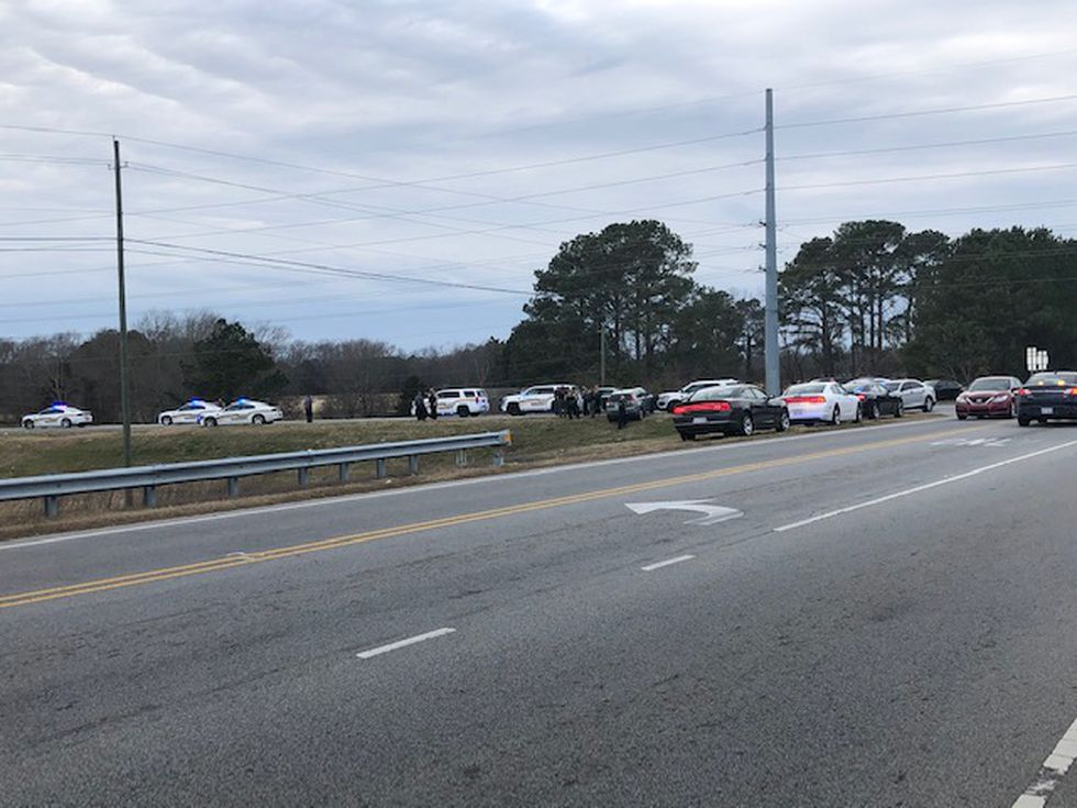 Sheriff's office stops vehicle of interest in homicide following chase.
