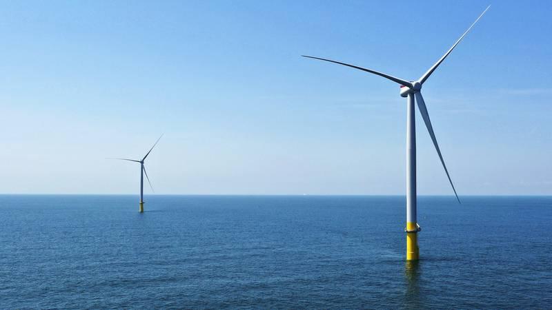 Two wind turbines, part of an offshore wind turbine project.  (AP Photo/Steve Helber)