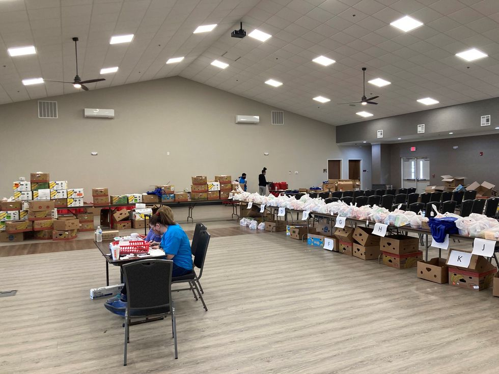 Pre-registered supply bags at the NC MedAssist free pharmacy event.