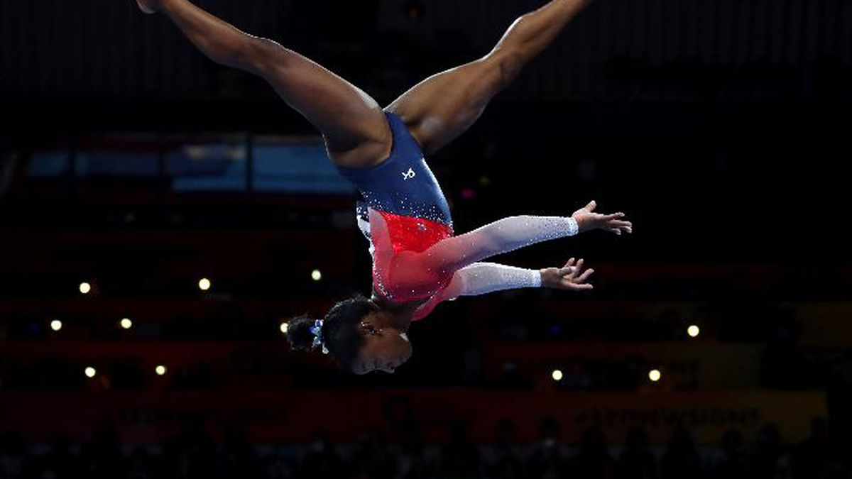 Simone Biles of the U.S. performs on the balance beam during women's team final at the Gymnastics World Championships in Stuttgart, Germany, Tuesday, Oct. 8, 2019. (AP Photo/Matthias Schrader)
