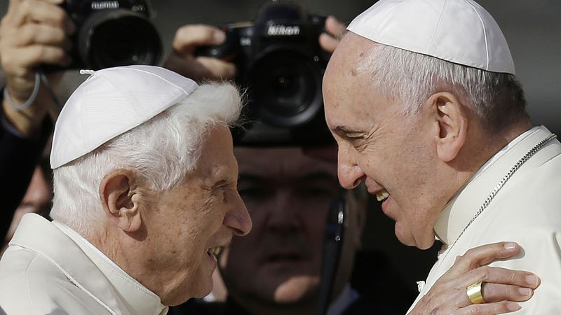 FILE - In this Sunday, Sept. 28, 2014 file photo, Pope Francis, right, hugs Emeritus Pope...