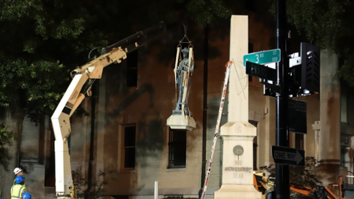 A statue on top of the Confederate monument outside the Pitt County courthouse is removed.