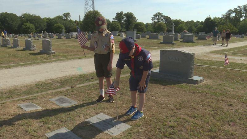 Scouts put flags at veteran gravesites