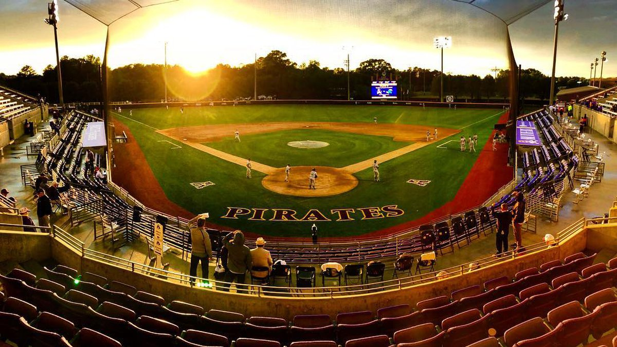 The sun sets beyond the the wall of Clark-LeClair Stadium.