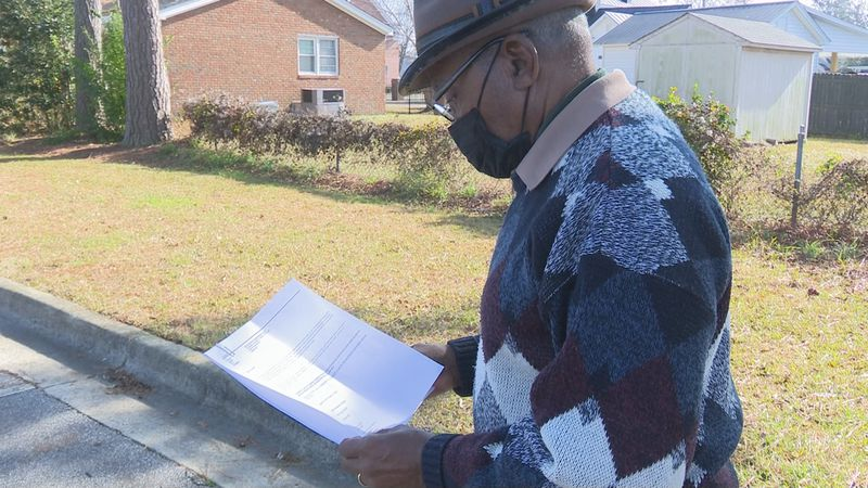 Calvin Henderson, Pitt County NAACP Chapter President, reads a statement from NAACP following...