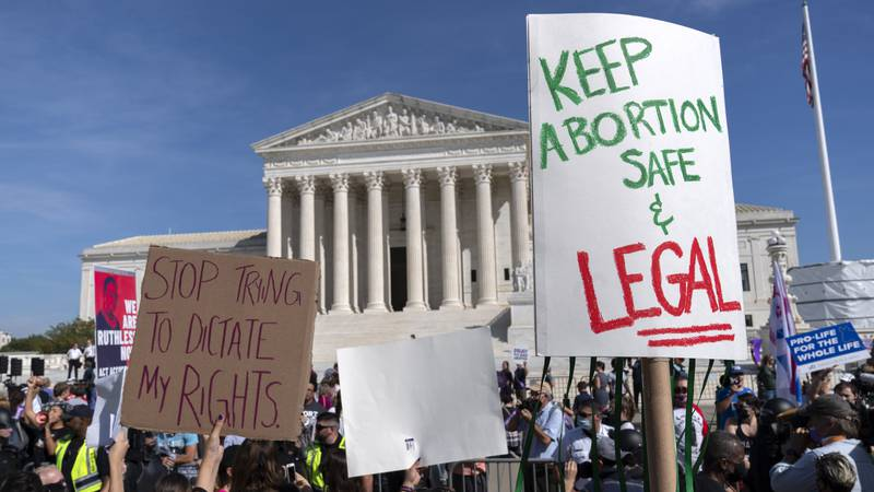 Demonstrators march outside of the the U.S. Supreme Court during the Women's March in...