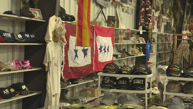 Local military surplus stores post flags in honor of Blue Star Welcome Week.