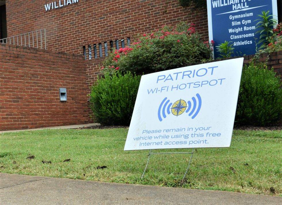 A sign for free WiFi sits in the parking lot of Patrick Henry Community College in...
