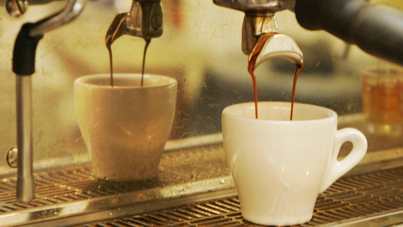 In this Thursday, Aug. 14, 2008 photo, espresso flows into a cup at a coffee house in Overland...