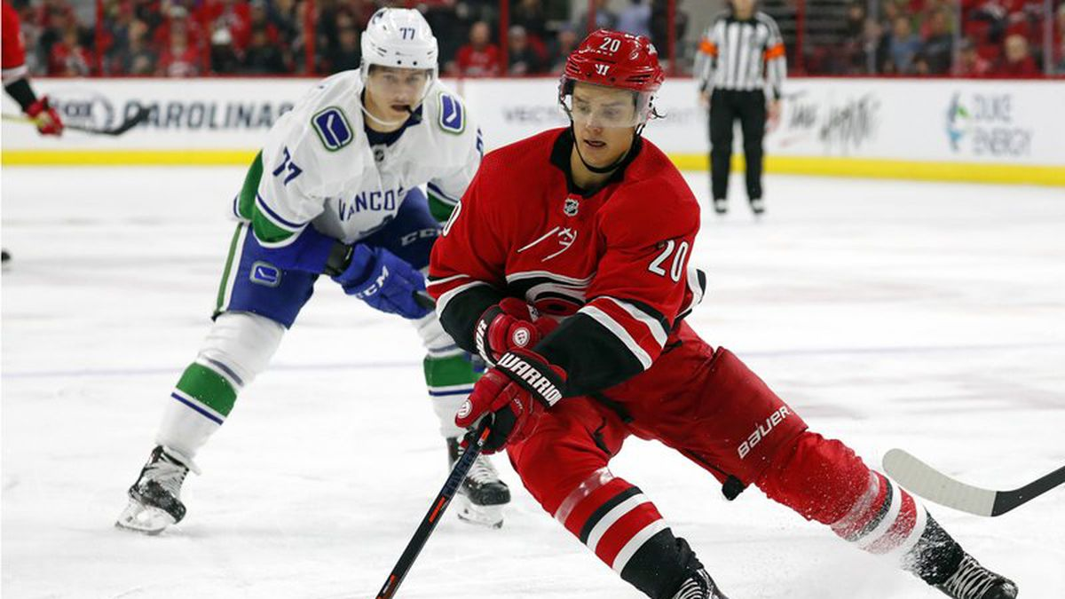 FILE - In this Oct. 9, 2018, file photo, Carolina Hurricanes' Sebastian Aho (20) gathers in the puck in front of Vancouver Canucks' Nikolay Goldobin (77) during the second period of an NHL hockey game in Raleigh, N.C. The Montreal Canadiens have tendered an offer sheet to Carolina Hurricanes restricted free agent forward Sebastian Aho.