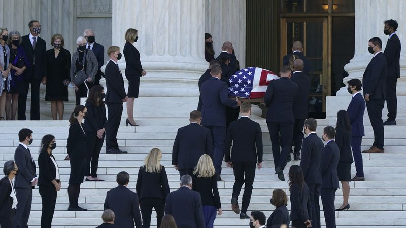The flag-draped casket of Justice Ruth Bader Ginsburg arrives at the Supreme Court in...