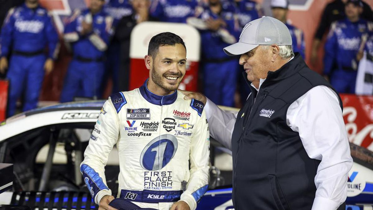 Car owner Rick Hendrick, right, congratulates Kyle Larson in victory lane after Larson won the...
