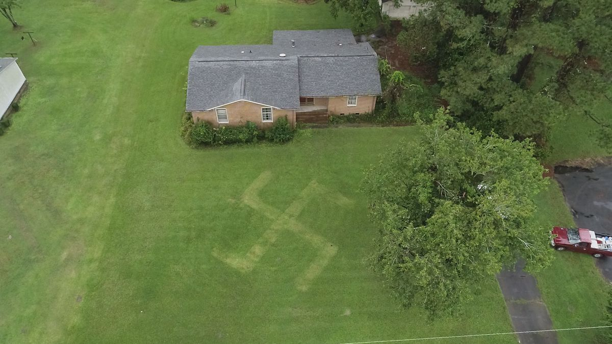 A swastika was mowed into the front lawn owned by a black family on Gum Branch Road outside of Richlands.