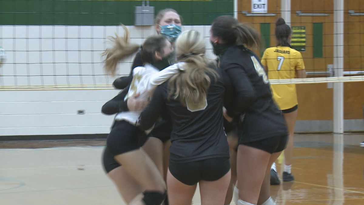 Ayden-Grifton Girls Volleyball celebrates after defeating Farmville Central in a five-set...