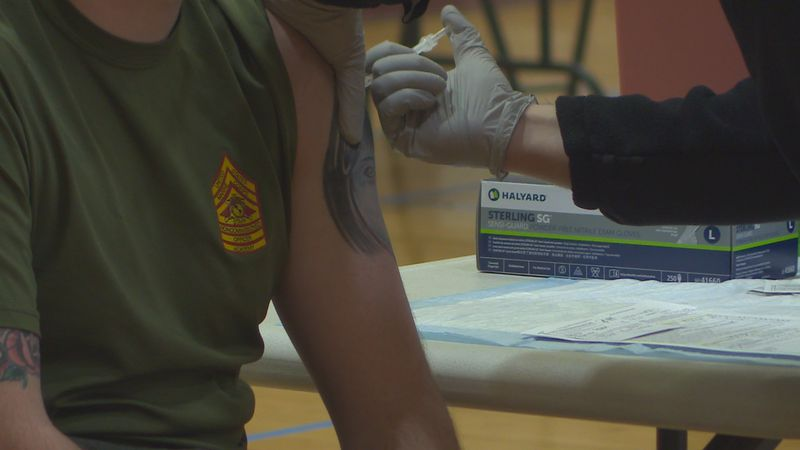 A marine gets a vaccine at Camp Lejeune.