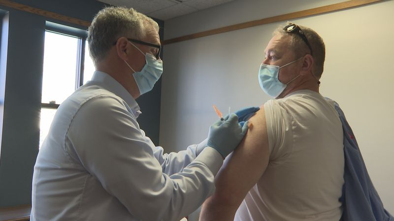 Pharmacist Neal O'Neal gives the Johnson & Johnson vaccine to a resident in Belhaven on...